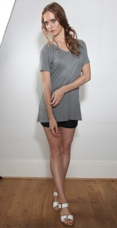 Look 23. Imani Jersey top and black Shorts